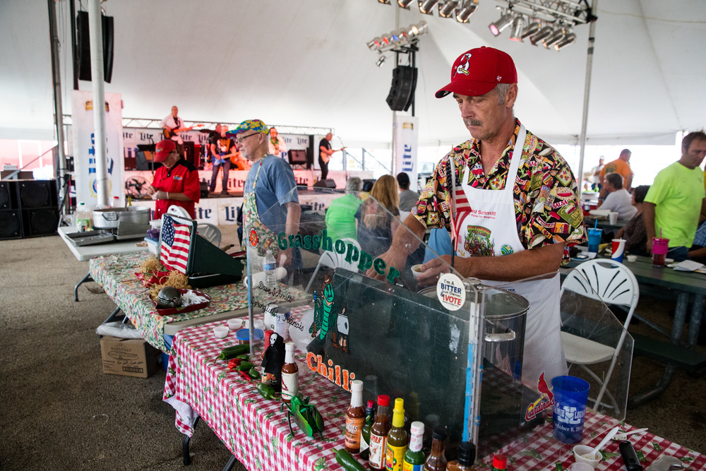 David Schmitt sets out samples for the public to try off his green chili during the Illinois State Fair Chili Cookoff, Sunday, Aug. 23, 2015, in Springfield, Ill. Justin L. Fowler/The State Journal-Register