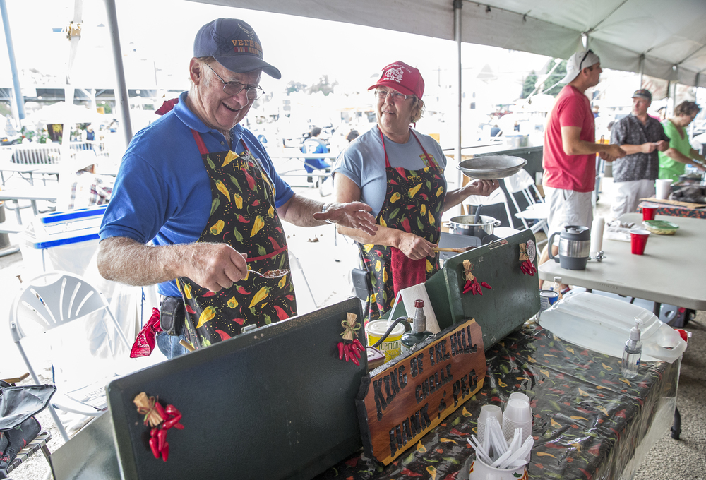 "Winn Ross, left, of Rochester, Ill., is happy with his red chili as he prepares it along side his cooking partner, Carolyn Wilson, right, of Taylorville, Ill., at their ""King of the Hill Chilli Hank & Peg"" table during the Illinois State Fair Chili Cookoff, Sunday, Aug. 23, 2015, in Springfield, Ill. Justin L. Fowler/The State Journal-Register"