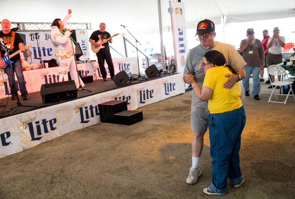 Ralph Gallagher dances with his daughter, Sheilah Gallagher, as Elvis Himselvis performs during the Illinois State Fair Chili Cookoff, Sunday, Aug. 23, 2015, in Springfield, Ill. Justin L. Fowler/The State Journal-Register