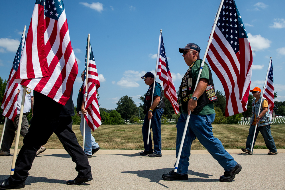 Members of the Patriot Guard and American Legion Motorcycle Riders march together to begin the ceremony to commemorate the 70th anniversary of the end of WWII at Camp Butler National Cemetery, Sunday, Aug. 16, 2015, in Springfield, Ill. Justin L. Fowler/The State Journal-Register