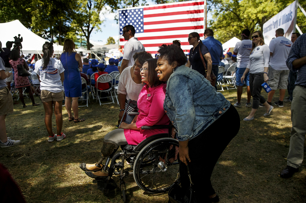Candidate for the U.S. Senate Tammy Duckworth poses for photos with guests after speaking at Democrat Day at the Illinois State Fair Thursday, Aug. 20, 2015. The two term Democratic congresswoman from suburban Chicago is running for Republican Sen. Mark Kirk's seat. Ted Schurter/The State Journal-Register