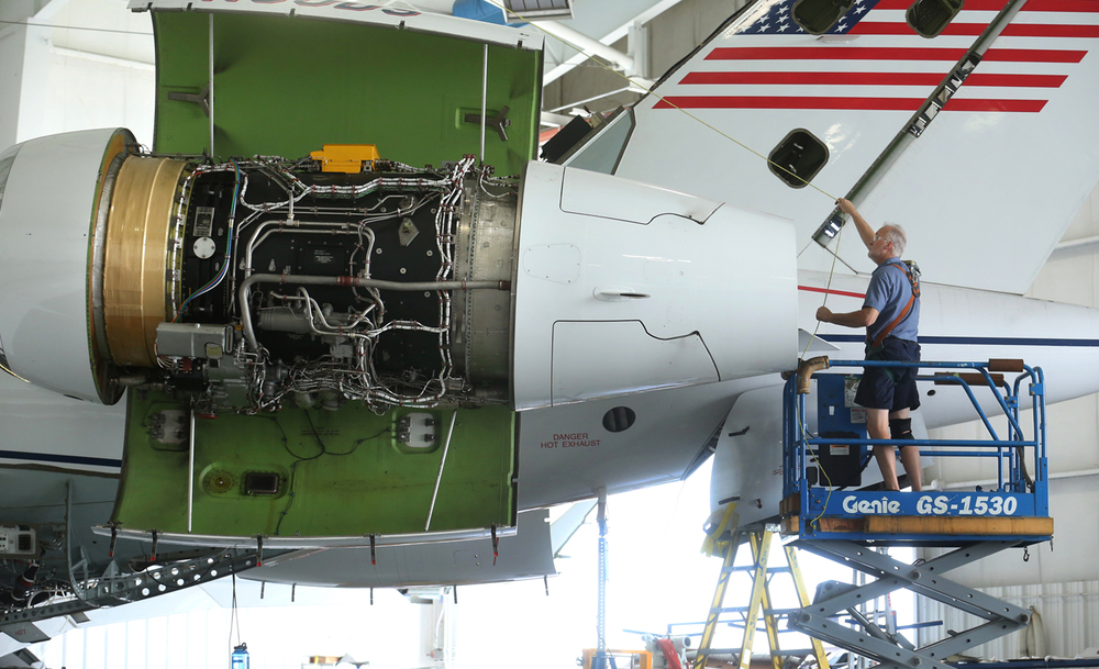 Mark Bargy, an engine technician at StandardAero Services, conducts an engine mount inspection on a Bombardier Global Express jet Friday, August 21, 2015 at Abraham Lincoln Capital Airport. StandardAero, which performs aircraft maintenance, repair and refurbishing on corporate and private jets, was recently purchased for $2.1 billion by New York-based Veritas Capital. David Spencer/The State Journal-Register