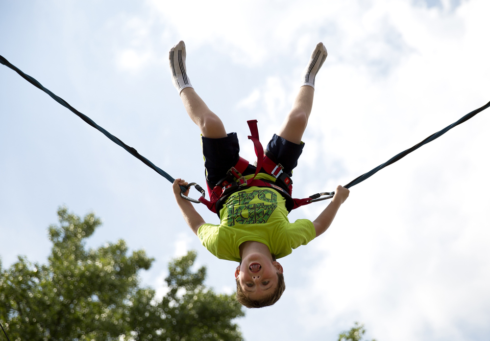Zaden Robison flips over his turn on the Power Jump in Adventure Village at the Illinois State Fair Monday, August 17, 2015 in Springfield, Ill. Rich Saal/The State Journal-Register