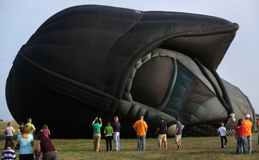 The Darth Vader balloon slowly inflates Thursday evening. David Spencer/The State Journal-Register