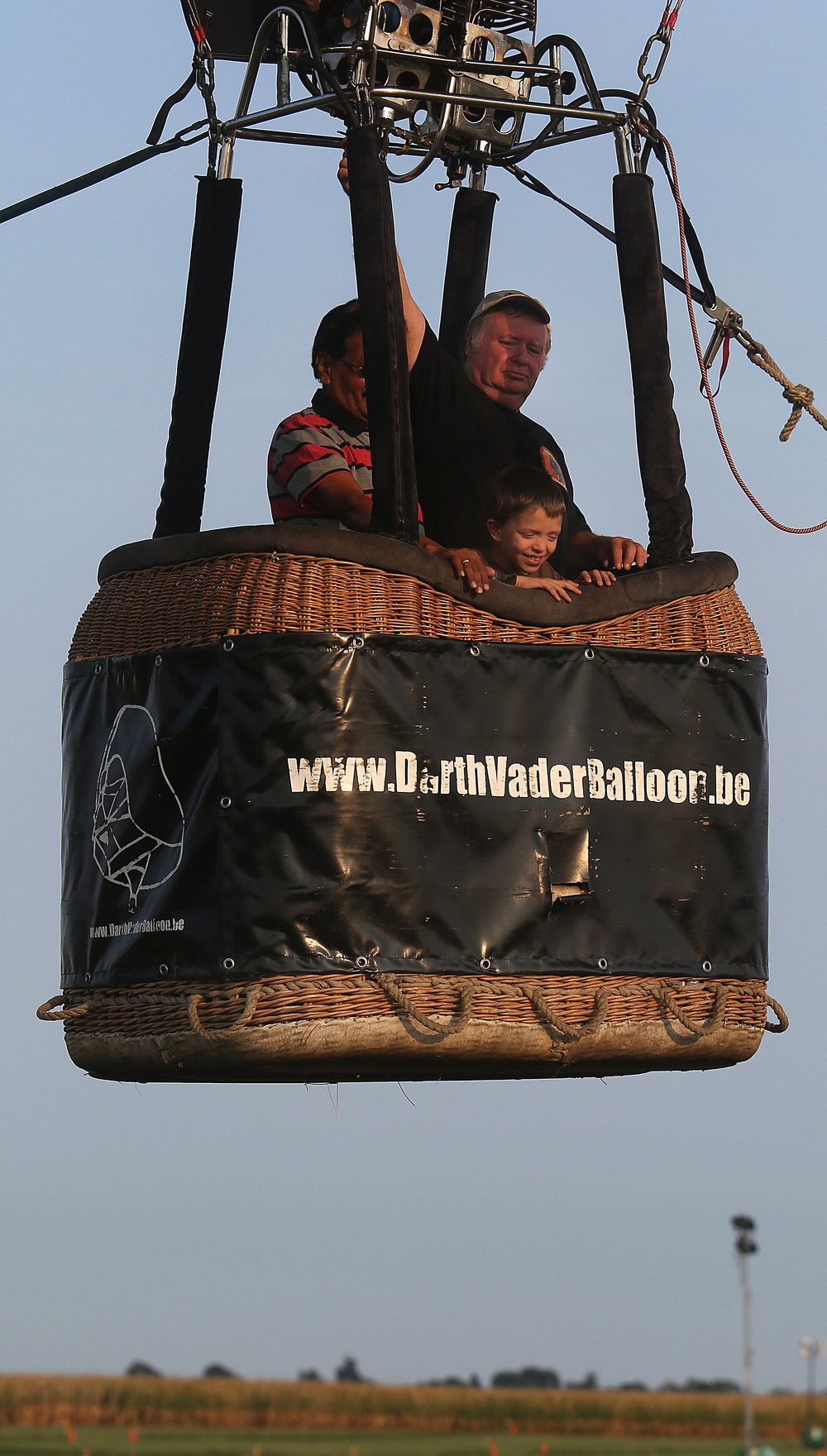 Children, including Aries Tanner, 10 of Lincoln seen in basket at front, got the opportunity to take a short ride up in the Darth Vader balloon while being tethered. Pilot Michel Lambert is behind Tanner. David Spencer/The State Journal-Register