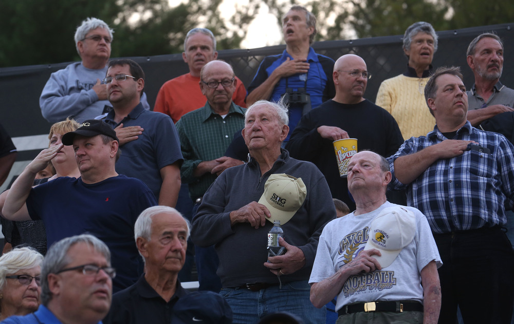 SHG fans stand during the playing of the National Anthem before the start of the game. David Spencer/The State Journal-Register