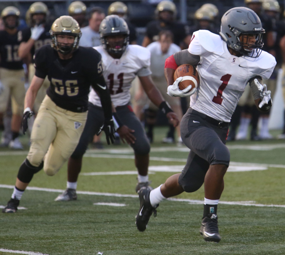 Senators ballcarrier Derek Jones sprints for yardage during first half action. David Spencer/The State Journal-Register
