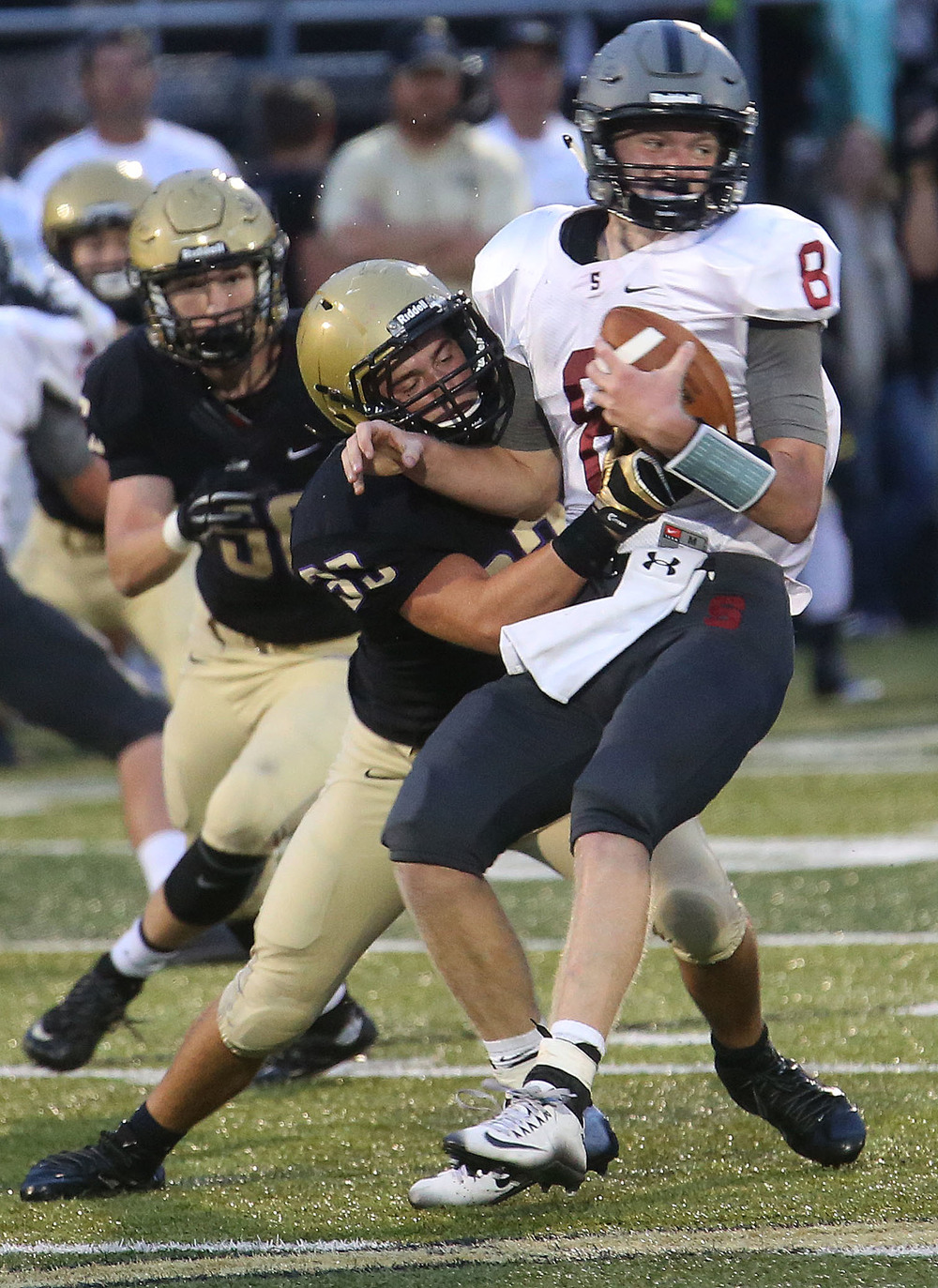 Senators quarterback Jackson Shearer is brought down by SHG defender Roger Dondanville. David Spencer/The State Journal-Register