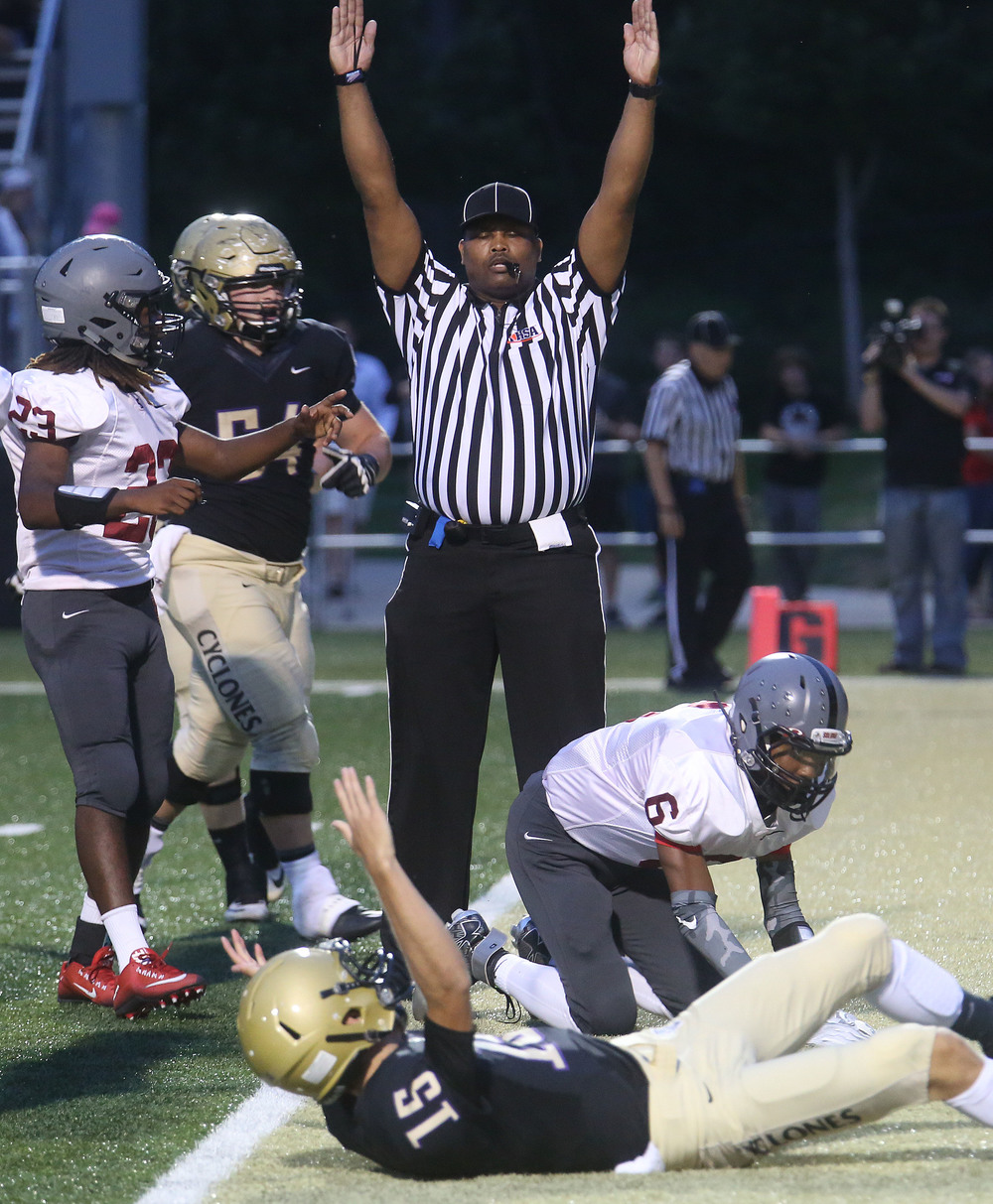 A referee calls a touchdown made by Cyclones quarterback Tim Brenneisen at bottom of frame Friday night. David Spencer/The State Journal-Register