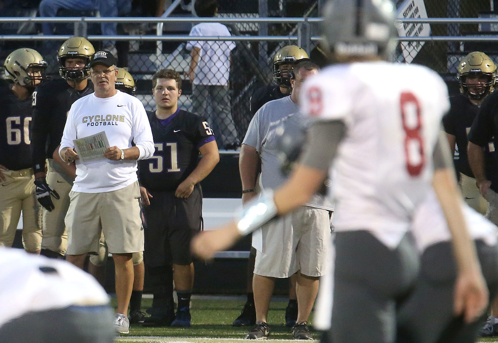 SHG head coach Ken Leonard at left looks on from the sidelines while SHS quarterback Jackson Shearer at right foreground prepares to get back into formation Friday night. David Spencer/The State Journal-Register