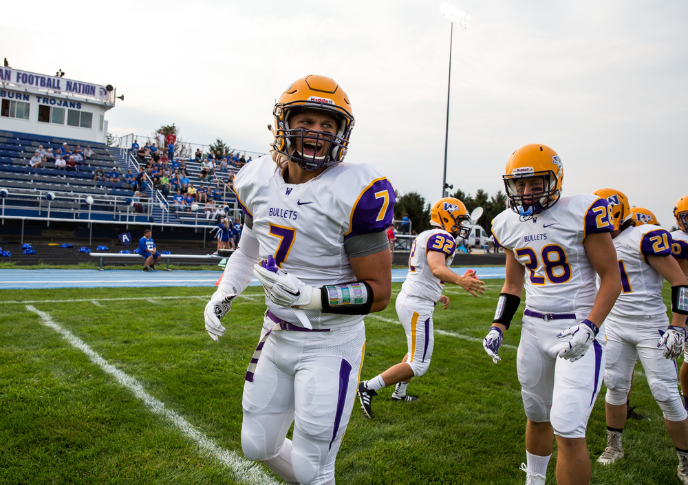 Williamsville's M.J. Haire (7) gets hyped up as the Bullets warm up prior to taking on Auburn at Michael J. Potts Memorial Field, Friday, Aug. 28, 2015, in Auburn, Ill. Justin L. Fowler/The State Journal-Register
