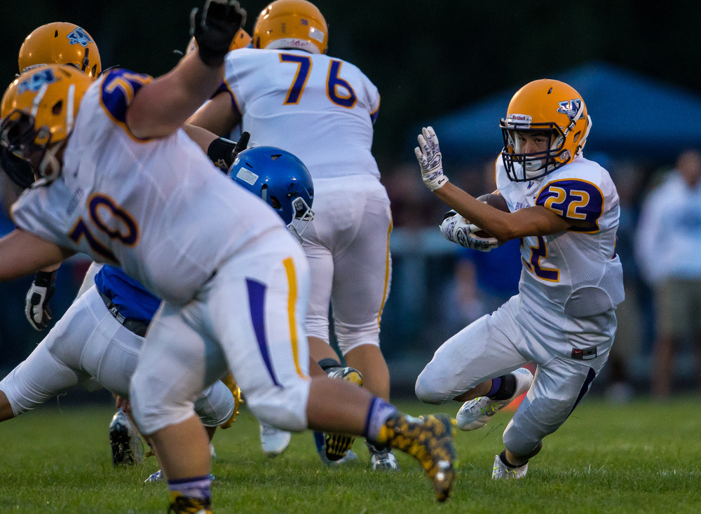 Williamsville's Hunter Thompson (22) cuts back after a catch against Auburn during the first half at Michael J. Potts Memorial Field, Friday, Aug. 28, 2015, in Auburn, Ill. Justin L. Fowler/The State Journal-Register