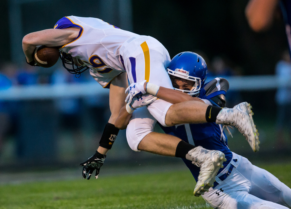 Williamsville's Quinn Higginbotham (16) goes in for a touchdown after a catch against Auburn's Benji Eaker (7) during the first half at Michael J. Potts Memorial Field, Friday, Aug. 28, 2015, in Auburn, Ill. Justin L. Fowler/The State Journal-Register