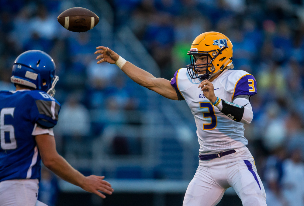 Williamsville's Vince Vignali (3) lets a touchdown pass fly against Auburn's Evan Patterson (66) during the first half at Michael J. Potts Memorial Field, Friday, Aug. 28, 2015, in Auburn, Ill. Justin L. Fowler/The State Journal-Register