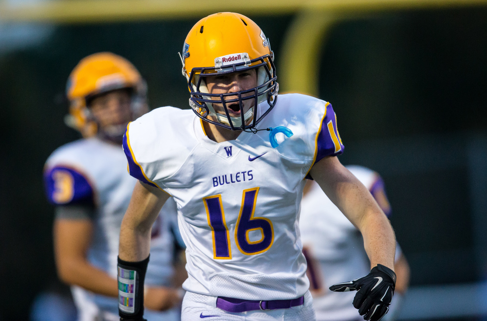 Williamsville's Quinn Higginbotham (16) is fired up after a touchdown catch against Auburn during the first half at Michael J. Potts Memorial Field, Friday, Aug. 28, 2015, in Auburn, Ill. Justin L. Fowler/The State Journal-Register