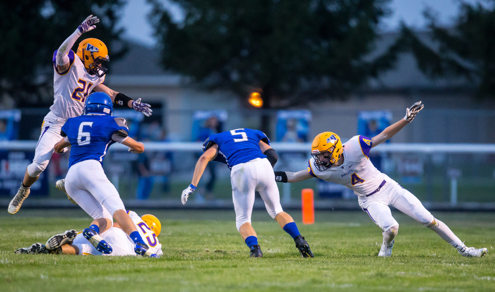 Auburn's Drew Points (5) avoids a tackle from Williamsville's Harrison Creswell (4) on his way to a 57-yard touchdown catch against Williamsville during the first half at Michael J. Potts Memorial Field, Friday, Aug. 28, 2015, in Auburn, Ill. Justin L. Fowler/The State Journal-Register