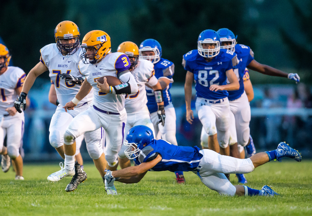 Williamsville's Vince Vignali (3) avoids a tackle from Auburn's Evan Grim (4) on his way to a touchdown during the first half at Michael J. Potts Memorial Field, Friday, Aug. 28, 2015, in Auburn, Ill. Justin L. Fowler/The State Journal-Register