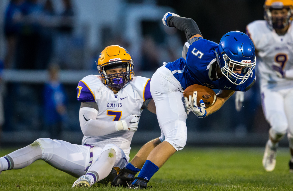 Auburn's Drew Points (5) tries to a spin out of a tackle from Williamsville's M.J. Haire (7) during the first half at Michael J. Potts Memorial Field, Friday, Aug. 28, 2015, in Auburn, Ill. Justin L. Fowler/The State Journal-Register