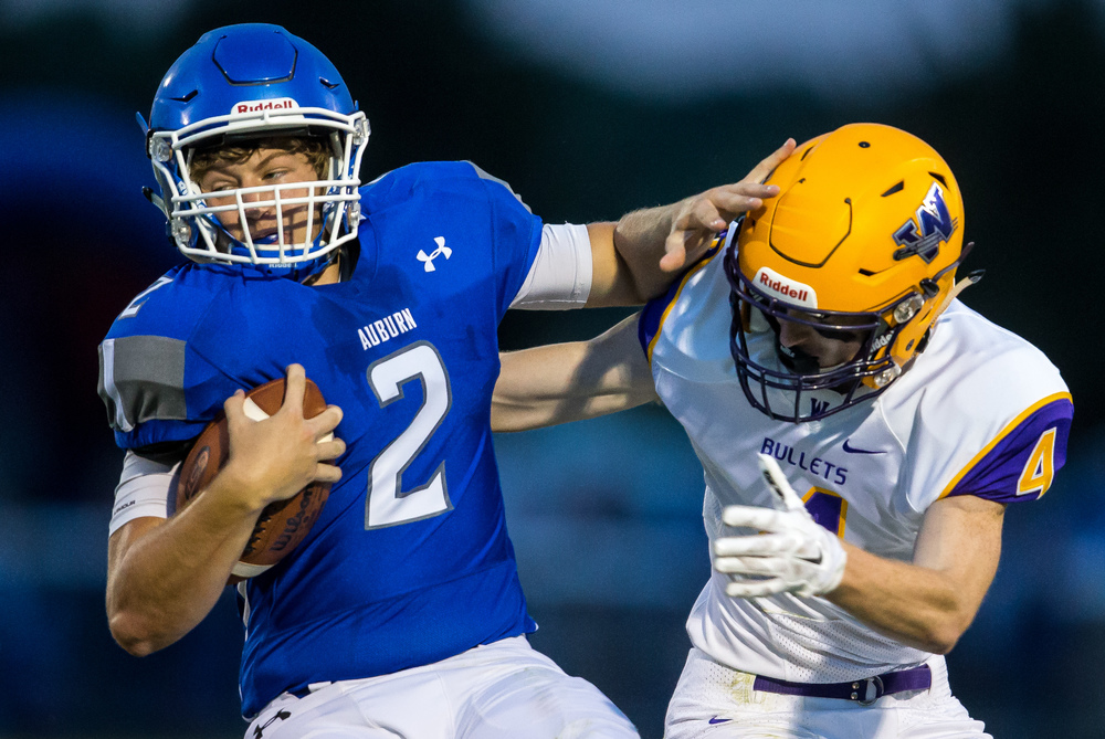Auburn quarterback Drew Chance (2) tries to spin away from Williamsville's Harrison Creswell (4) on a rush during the first half at Michael J. Potts Memorial Field, Friday, Aug. 28, 2015, in Auburn, Ill. Justin L. Fowler/The State Journal-Register