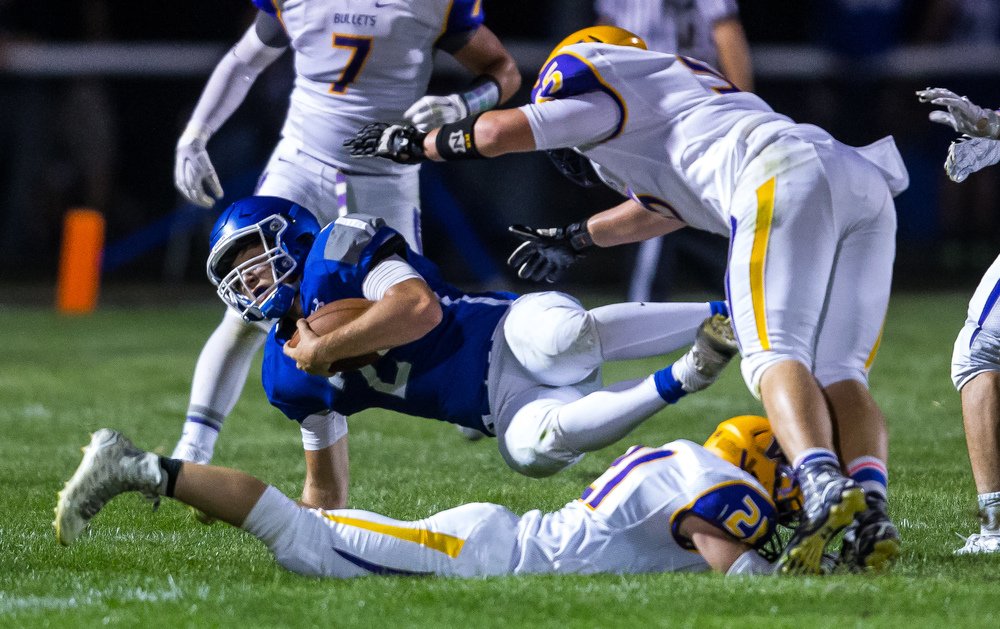 Auburn quarterback Drew Chance (2) is taken down by Williamsville's Cade Beckett (21) on a rush during the second half at Michael J. Potts Memorial Field, Friday, Aug. 28, 2015, in Auburn, Ill. Justin L. Fowler/The State Journal-Register