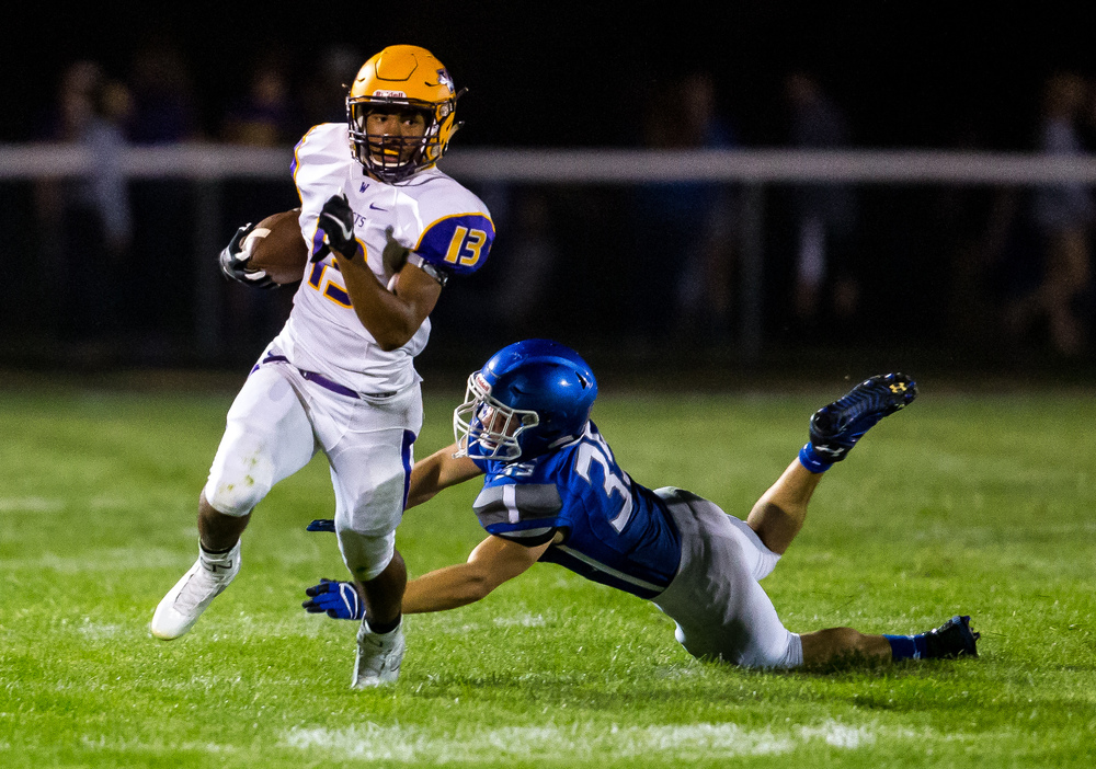 Williamsville's Jace Franklin (13) take off on a rush as he avoids the tackle from Auburn's Colton McDannald (35) during the second half at Michael J. Potts Memorial Field, Friday, Aug. 28, 2015, in Auburn, Ill. Justin L. Fowler/The State Journal-Register