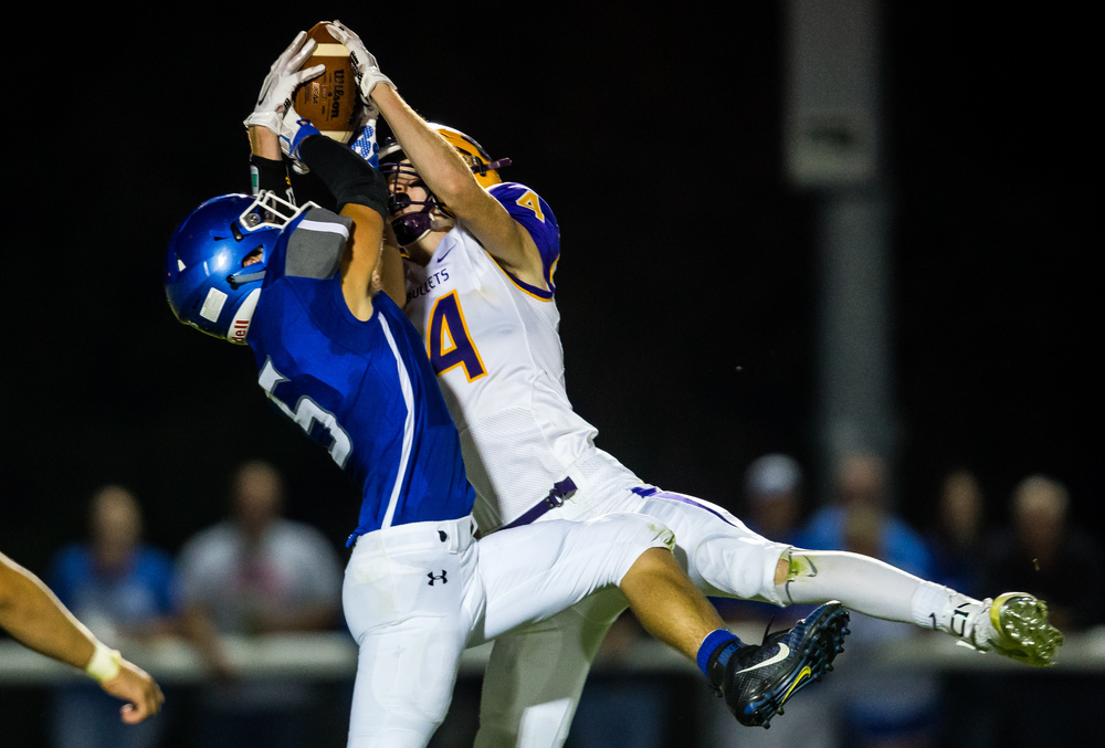 Williamsville's Harrison Creswell (4) intercepts a pass intended for Auburn's Drew Points (5) during the second half at Michael J. Potts Memorial Field, Friday, Aug. 28, 2015, in Auburn, Ill. Justin L. Fowler/The State Journal-Register