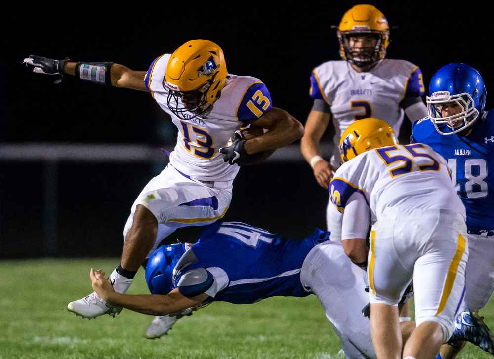 Williamsville's Jace Franklin (13) tries to jump over tackle from Auburn during the second half at Michael J. Potts Memorial Field, Friday, Aug. 28, 2015, in Auburn, Ill. Justin L. Fowler/The State Journal-Register
