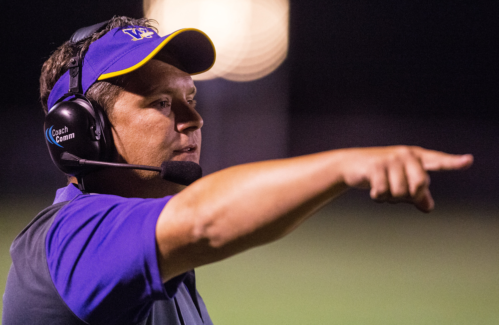 Williamsville head football coach Aaron Kunz calls out instructions for the defense as they take on Auburn during the second half at Michael J. Potts Memorial Field, Friday, Aug. 28, 2015, in Auburn, Ill. Justin L. Fowler/The State Journal-Register
