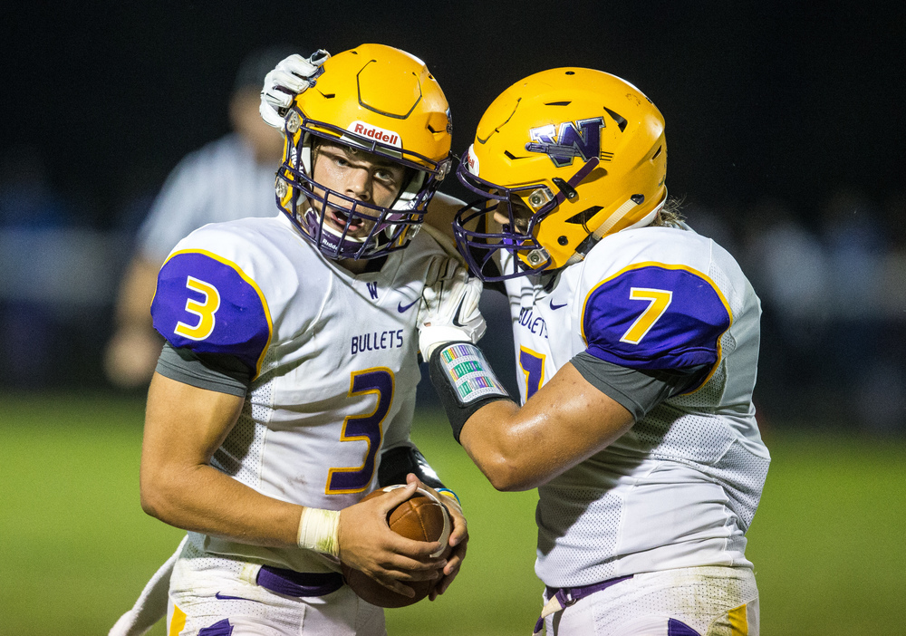 Williamsville's Vince Vignali (3) is congratulated by Williamsville's M.J. Haire (7) after an interception against Auburn during the second half at Michael J. Potts Memorial Field, Friday, Aug. 28, 2015, in Auburn, Ill. Justin L. Fowler/The State Journal-Register
