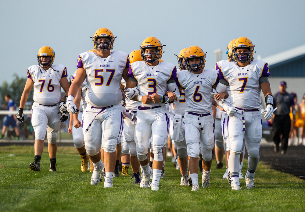 The Williamsville Bullets walk out on the field to take on Auburn at Michael J. Potts Memorial Field, Friday, Aug. 28, 2015, in Auburn, Ill. Justin L. Fowler/The State Journal-Register