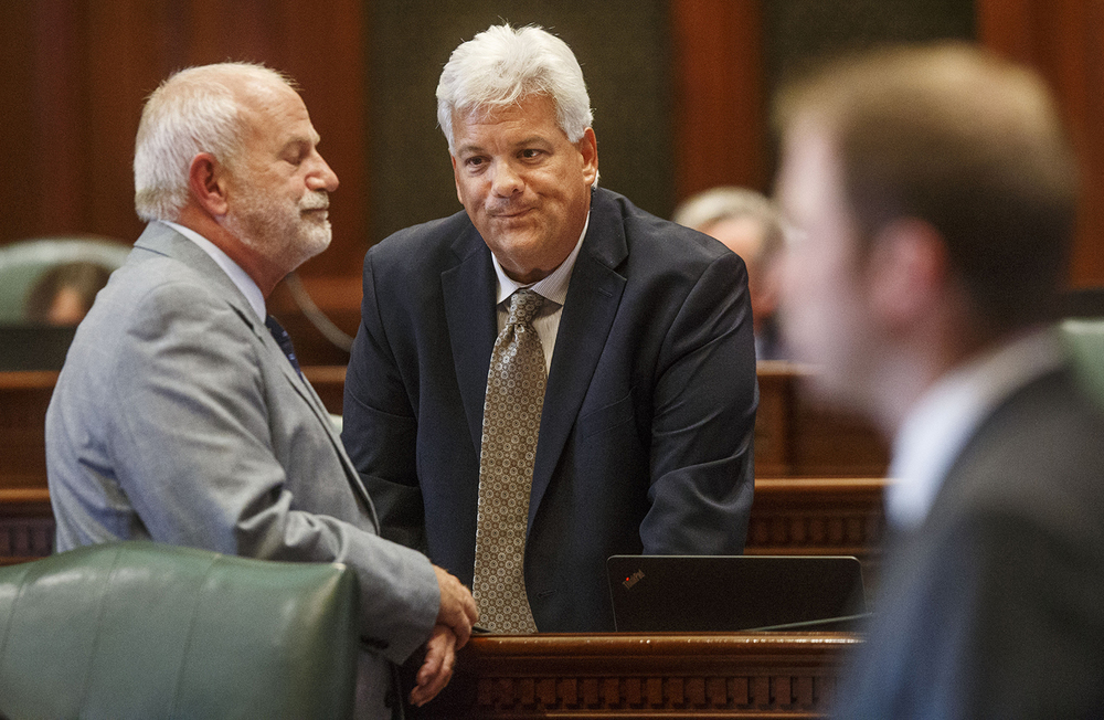 Illinois Rep. Jack D. Franks, D-Marengo, ends a conversation with spokesman for the Illinois Speaker of the House Michael Madigan, during debate on overriding Gov. Bruce Rauner's amendatory veto of SB1229. The bill, which would have removed the threat of a strike or lockout if union contract negotiations break down, failed to pass by three votes. Franks was the only Democrat who voted present.  Ted Schurter/The State Journal-Register