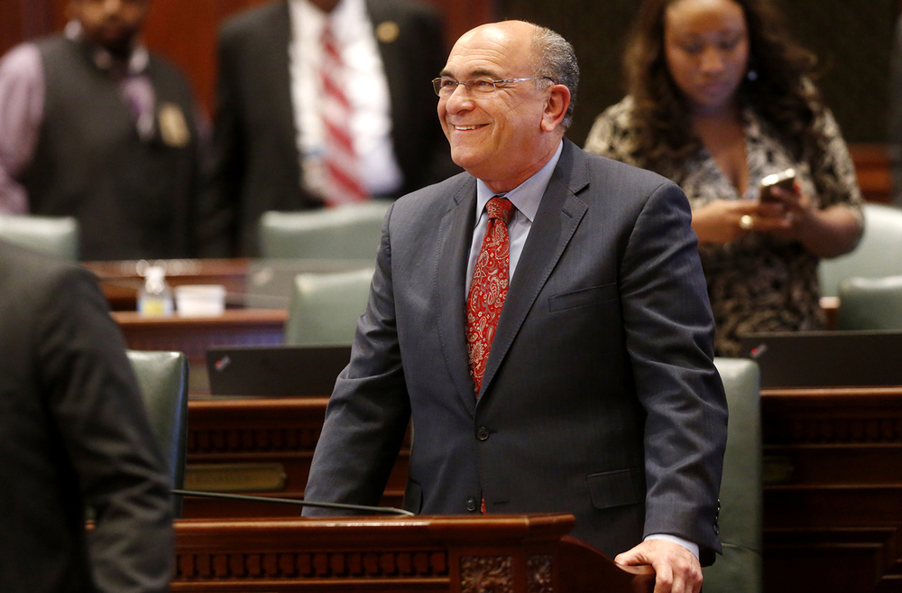 Illinois Rep. Lou Lang, D-Skokie, smiles as the votes come in 105-5 to override Gov. Bruce Rauner's veto of heroin bill that took out Medicaid coverage Wednesday, Sept. 2, 2015. Ted Schurter/The State Journal-Register