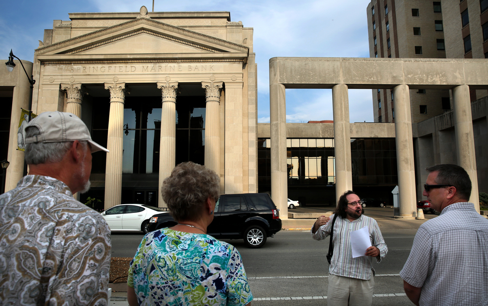 Originally built in 1927, the Springfield Marine Bank building in downtown Springfield was one of the stops made by the tour, with Anthony Rubano at right explaining the 1974-76 addition done by the Ferry & Henderson architectural firm. The building now houses Chase bank. David Spencer/The State Journal-Register