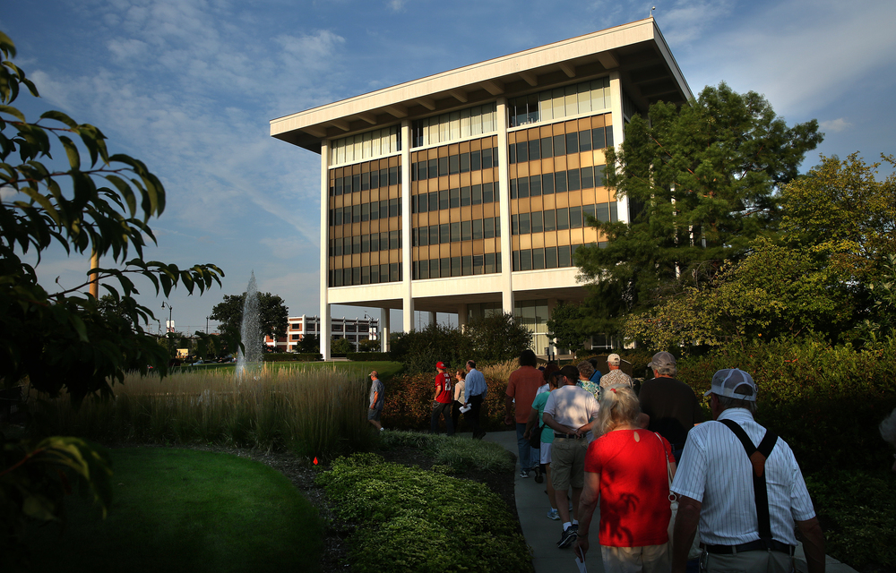 Those taking part in the tour walk towards the Horace Mann building in Springfield early Wednesday evening. Designed by architect Minoru Yamasaki, construction of the headquarters of Horace Mann Educators Corp. began in 1968 and was completed in June 1972. David Spencer/The State Journal-Register