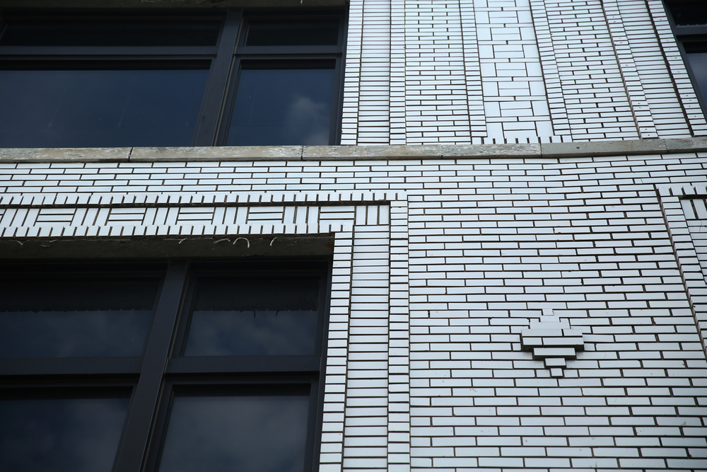 "A detail shows the white brick facade of 618 E. Washington St., a commercial building included on the tour which guide Anthony Rubano described as done in the ""Reductive Classical Style"" -which he admitted was only a slight improvement for what most describe a similar building as: ""20th Century Commercial"". David Spencer/The State Journal-Register"