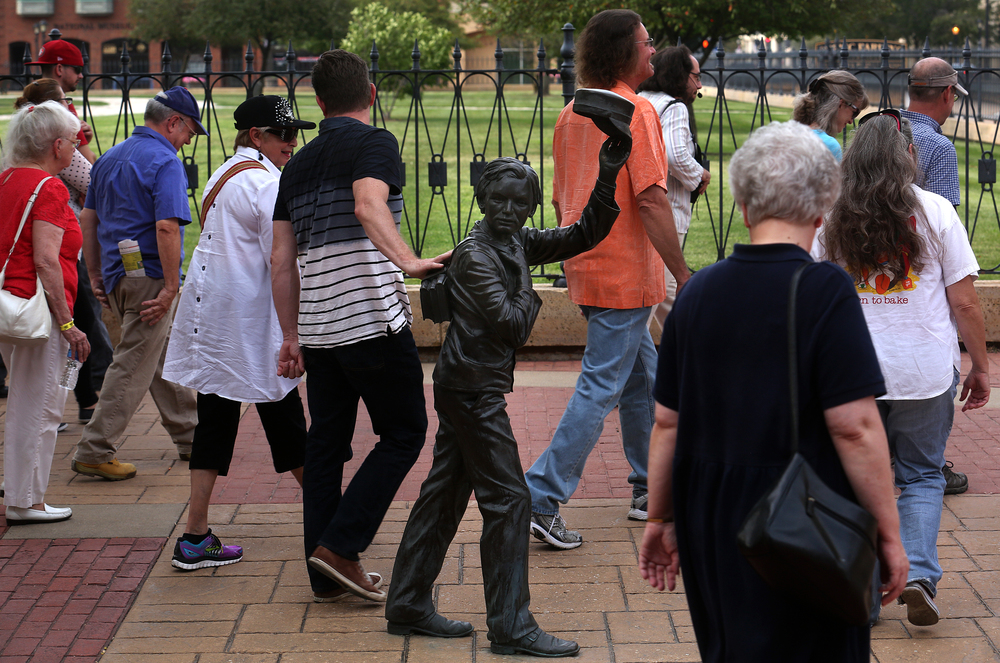 The Wednesday evening tour departs from in front of the Lincoln-Herndon Law Offices, with one pied piper giving the sculpture of Robert Todd Lincoln a quick pat of the hand. David Spencer/The State Journal-Register