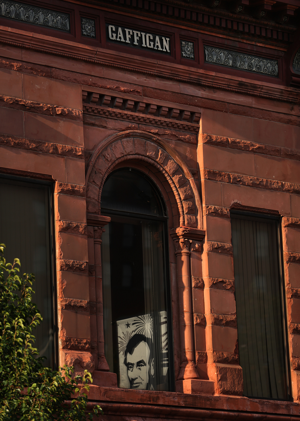 "A large columned archway is one of the defining features of the facade of the Gaffigan Building, located at 629 E. Washington Street. Built in the late 19th Century from red sandstone, tour guide Rubano explained it was done in ""Richardsonian Romanesque"", an architectural style named after American architect Henry Hobson Richardson. (1838-1886)  David Spencer/The State Journal-Register"