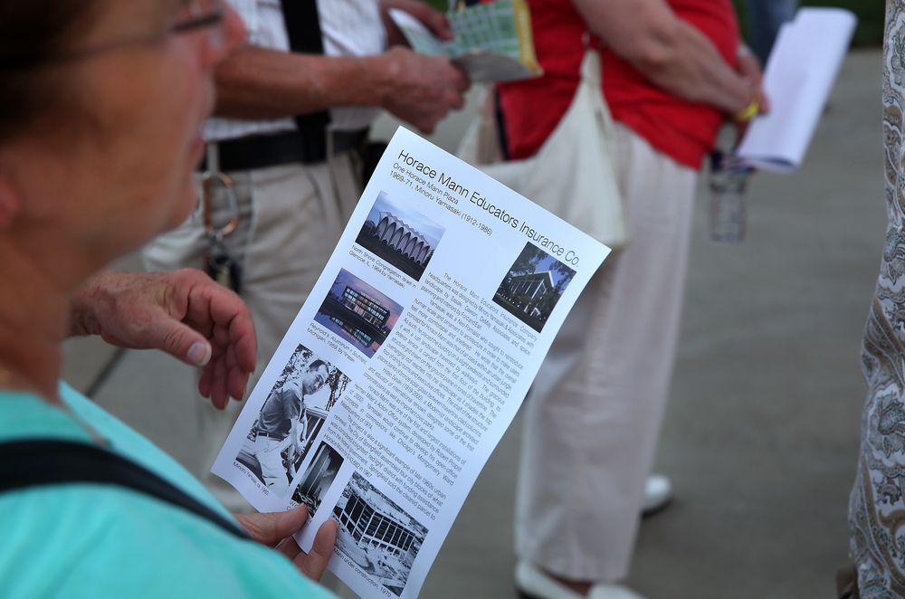 Fact sheets on specific buildings are distributed during the tour, with one attendee holding a sheet for the Horace Mann Educators Insurance Company here.  David Spencer/The State Journal-Register