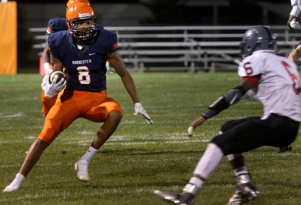 Rochester ball carrier Collin Stallworth returns the ball late in first half action to set up a touchdown made by teammate Avante Cox. David Spencer/The State Journal-Register