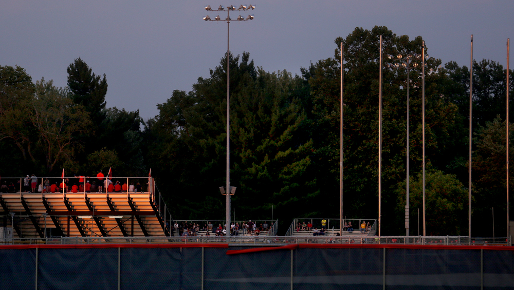 The last remaining light of a hot and muggy day strikes the underside of the aluminum bleachers on the home side at Rockets Stadium before the start of the game. David Spencer/The State Journal-Register