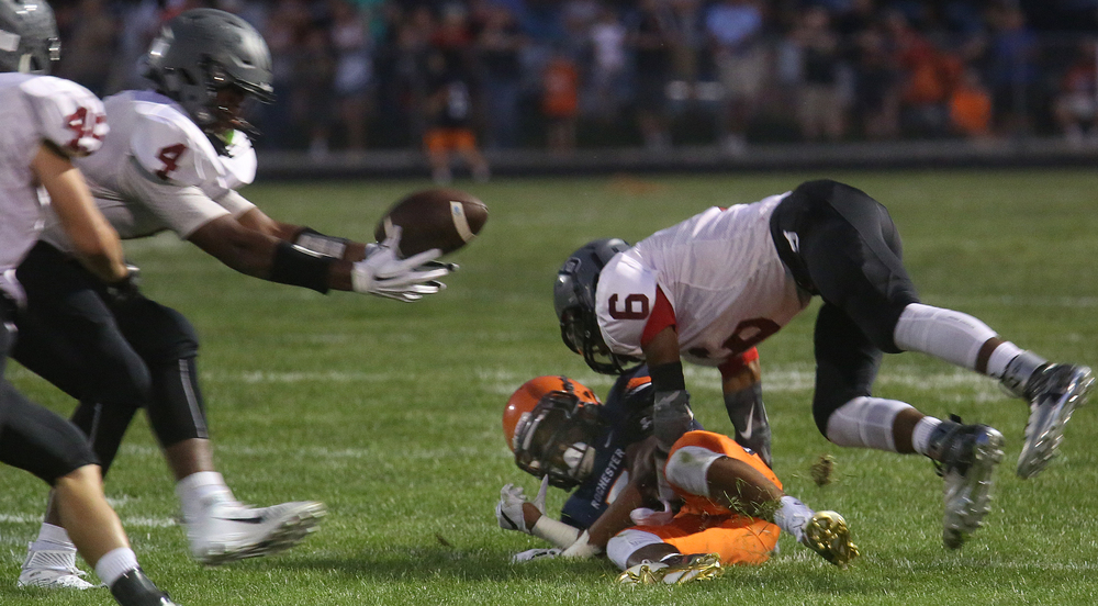 Senators player Rahkeem Hawkins recovers a fumble from a Rockets receiver after he was hit by teammate Davonte Day in first half action. David Spencer/The State Journal-Register