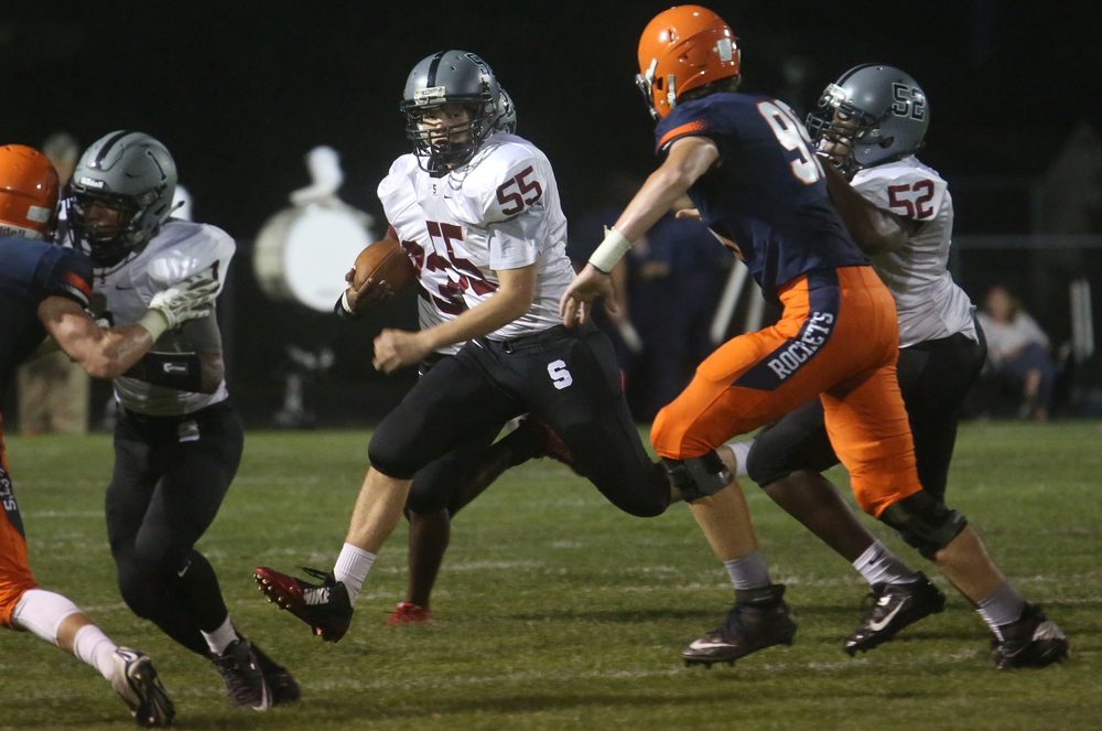 Senators ball carrier Benjamin Miller gains yardage Friday night. David Spencer/The State Journal-Register