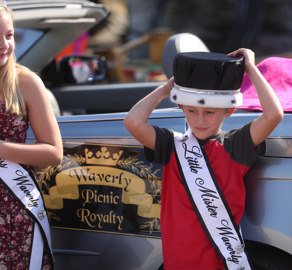 Area royalty assembled off the village square before riding in the parade. Little Mister Waverly-Drew Johnson, 7, places his crown on his head before hopping in his trusty carriage behind him. Also riding was Junior Miss Waverly Rylie Pettis, 12 at left. David Spencer/The State Journal-Register