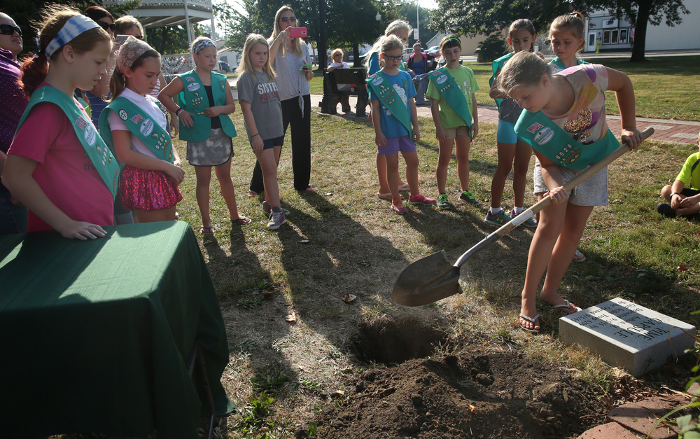 Each Girl Scout from Troop #6209 shoveled a bit of soil over the time capsule during a short ceremony in Community Park on the village square early Saturday morning. The capsule is scheduled to be opened on Sept. 5, 2065. David Spencer/The State Journal-Register