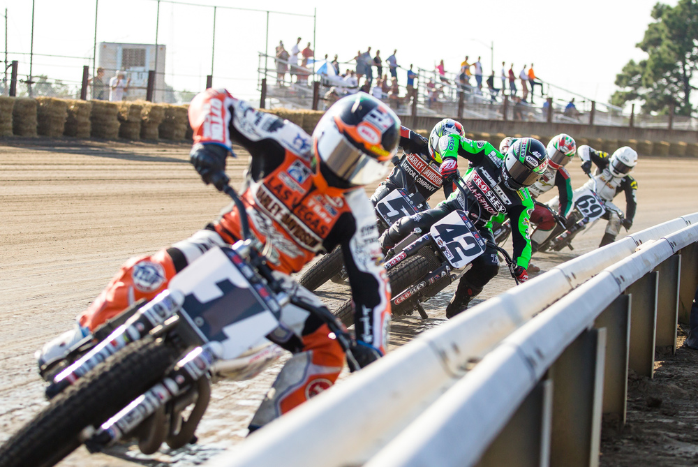 Jared Mees, left, on his #1 Harley Davidson, leads Bryan Smith, on his #42 Kawasaki, around turn one in the opening laps during the AMA Pro Flat Track Grand National Championship Springfield Mile II at the Illinois State Fairgrounds, Sunday, Sept. 6, 2015, in Springfield, Ill. Justin L. Fowler/The State Journal-Register