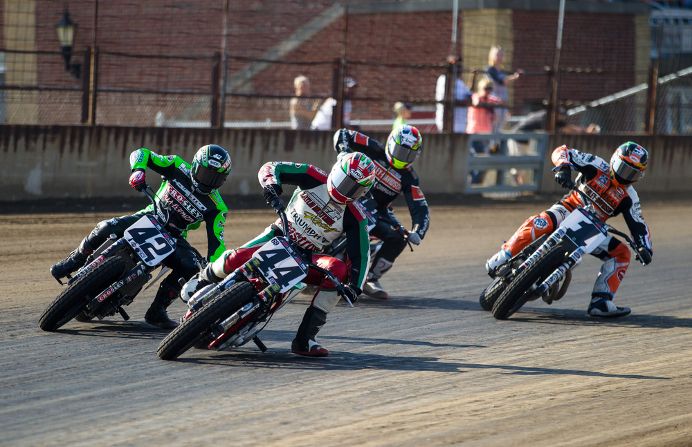 Brandon Robinson, on his #44 Triumph, takes the lead going into turn one during the AMA Pro Flat Track Grand National Championship Springfield Mile II at the Illinois State Fairgrounds, Sunday, Sept. 6, 2015, in Springfield, Ill. Justin L. Fowler/The State Journal-Register
