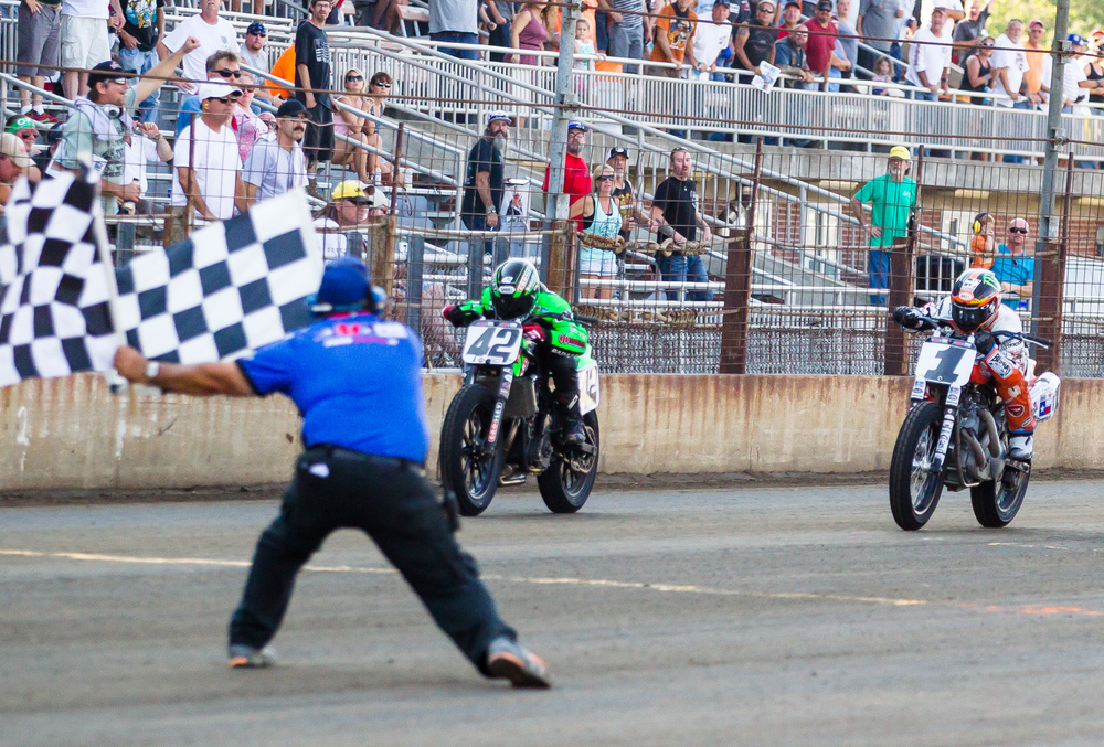 Bryan Smith, on his #42 Kawasaki, takes the checkered flag for his sixth win at the AMA Pro Flat Track Grand National Championship Springfield Mile II at the Illinois State Fairgrounds, Sunday, Sept. 6, 2015, in Springfield, Ill. Justin L. Fowler/The State Journal-Register