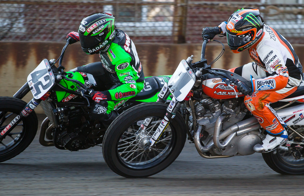 Bryan Smith, on his #42 Kawasaki, battles it out on the front stretch with Jared Mees, on his #1 Harley-Davidson, during the AMA Pro Flat Track Grand National Championship Springfield Mile II at the Illinois State Fairgrounds, Sunday, Sept. 6, 2015, in Springfield, Ill. Justin L. Fowler/The State Journal-Register