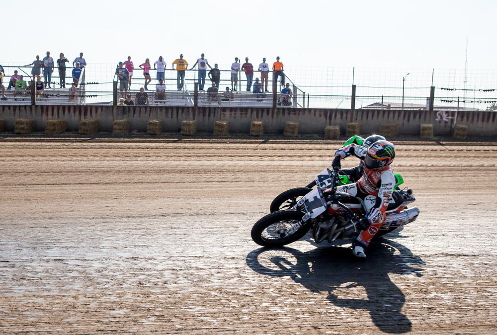 Jared Mees on his #1 Harley-Davidson is neck and neck with Bryan Smith and his #42 Kawasaki going into turn one during the AMA Pro Flat Track Grand National Championship Springfield Mile II at the Illinois State Fairgrounds, Sunday, Sept. 6, 2015, in Springfield, Ill. Justin L. Fowler/The State Journal-Register