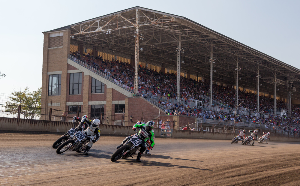 Bryan Smith slides his #42 Kawasaki to the inside and the lead during the AMA Pro Flat Track Grand National Championship Springfield Mile II at the Illinois State Fairgrounds, Sunday, Sept. 6, 2015, in Springfield, Ill. Justin L. Fowler/The State Journal-Register